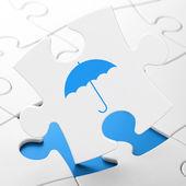 Safety concept: Umbrella on puzzle background — Stockfoto
