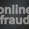 Stock Photo: Safety concept: Online Fraud on chalkboard background