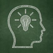 Marketing concept: Head With Lightbulb on chalkboard background — Stock Photo