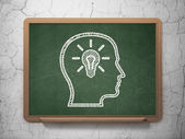 Education concept: Head With Lightbulb on chalkboard background — Stockfoto