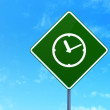 Timeline concept: Clock on road sign background — Stock Photo