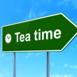 Time concept: Tea Time and Clock on road sign background — Stock Photo