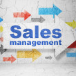 Advertising concept: arrow whis Sales Management on grunge wall background — Stock Photo