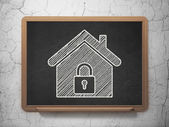 Security concept: Home on chalkboard background — Stock Photo