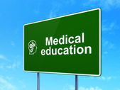 Education concept: Medical Education and Head With Gears on road sign background — Stock Photo