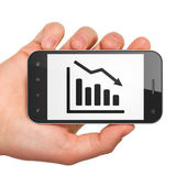 Business concept: Decline Graph on smartphone — Stock Photo