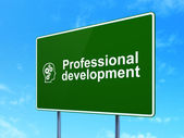 Education concept: Professional Development and Head With Gears on road sign background — Stock Photo