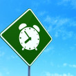 Timeline concept: Alarm Clock on road sign background — Stock Photo