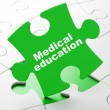 Education concept: Medical Education on puzzle background — Стоковая фотография