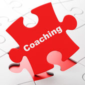 Education concept: Coaching on puzzle background — Stock Photo