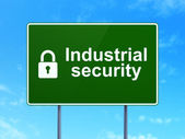Safety concept: Industrial Security and Closed Padlock on road sign background — Foto Stock