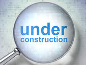 SEO web design concept: Under Construction with optical glass — Stock Photo