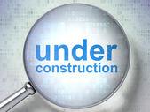 SEO web design concept: Under Construction with optical glass — Fotografia Stock