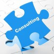 Finance concept: Consulting on puzzle background — Stock Photo