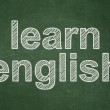 Education concept: Learn English on chalkboard background — Stock Photo