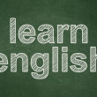 Stock Photo: Education concept: Learn English on chalkboard background