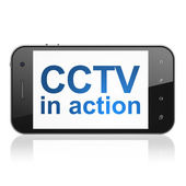 Security concept: CCTV In action on smartphone — Stock Photo