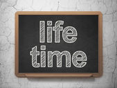 Time concept: Life Time on chalkboard background — Stock Photo