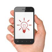 Finance concept: Light Bulb on smartphone — ストック写真
