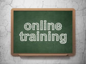 Education concept: Online Training on chalkboard background — Stock Photo