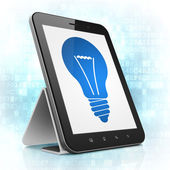 Finance concept: Light Bulb on tablet pc computer — ストック写真