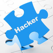 Security concept: Hacker on puzzle background — Stock Photo