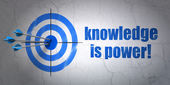 Education concept: target and Knowledge Is power! on wall background — Zdjęcie stockowe