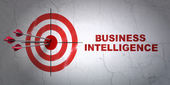 Finance concept: target and Business Intelligence on wall background — Stock Photo