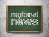 News concept: Regional News on chalkboard background — Stock Photo