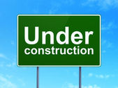Web design concept: Under Construction on road sign background — Stock Photo
