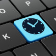 Stock Photo: Time concept: Clock on computer keyboard background