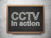 Privacy concept: CCTV In action on chalkboard background — Stock Photo