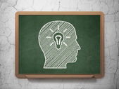 Information concept: Head With Light Bulb on chalkboard background — Stock Photo