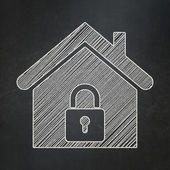 Protection concept: Home on chalkboard background — Stock Photo