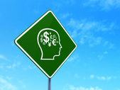 Marketing concept: Head With Finance Symbol on road sign background — Stock Photo