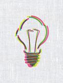 Notion de finance : ampoule sur fond de texture de tissu — Photo