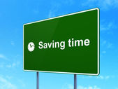 Timeline concept: Saving Time and Clock on road sign background — Stock Photo