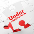 Web development concept: Under Construction on puzzle background — Stock Photo