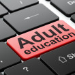 Education concept: Adult Education on computer keyboard background — Stock Photo #35877429