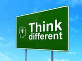 Education concept: Think Different and Head With Lightbulb on road sign background — Stock Photo