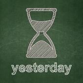 Timeline concept: Hourglass and Yesterday on chalkboard background — ストック写真