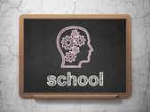 Education concept: Head With Gears and School on chalkboard background — Stock Photo