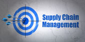 Marketing concept: target and Supply Chain Management on wall background — Stock Photo
