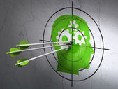 Business concept: arrows in Head With Gears target on wall background — Stock Photo