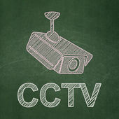 Protection concept: Cctv Camera and CCTV on chalkboard background — Stock Photo
