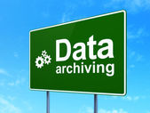 Data concept: Data Archiving and Gears on road sign background — Stock Photo