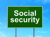 Safety concept: Social Security on road sign background — Stock Photo