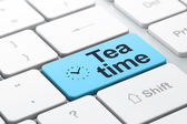 Time concept: Clock and Tea Time on computer keyboard background — Stockfoto