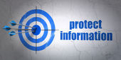 Protection concept: target and Protect Information on wall background — Stock Photo