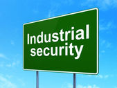 Protection concept: Industrial Security on road sign background — Stock Photo